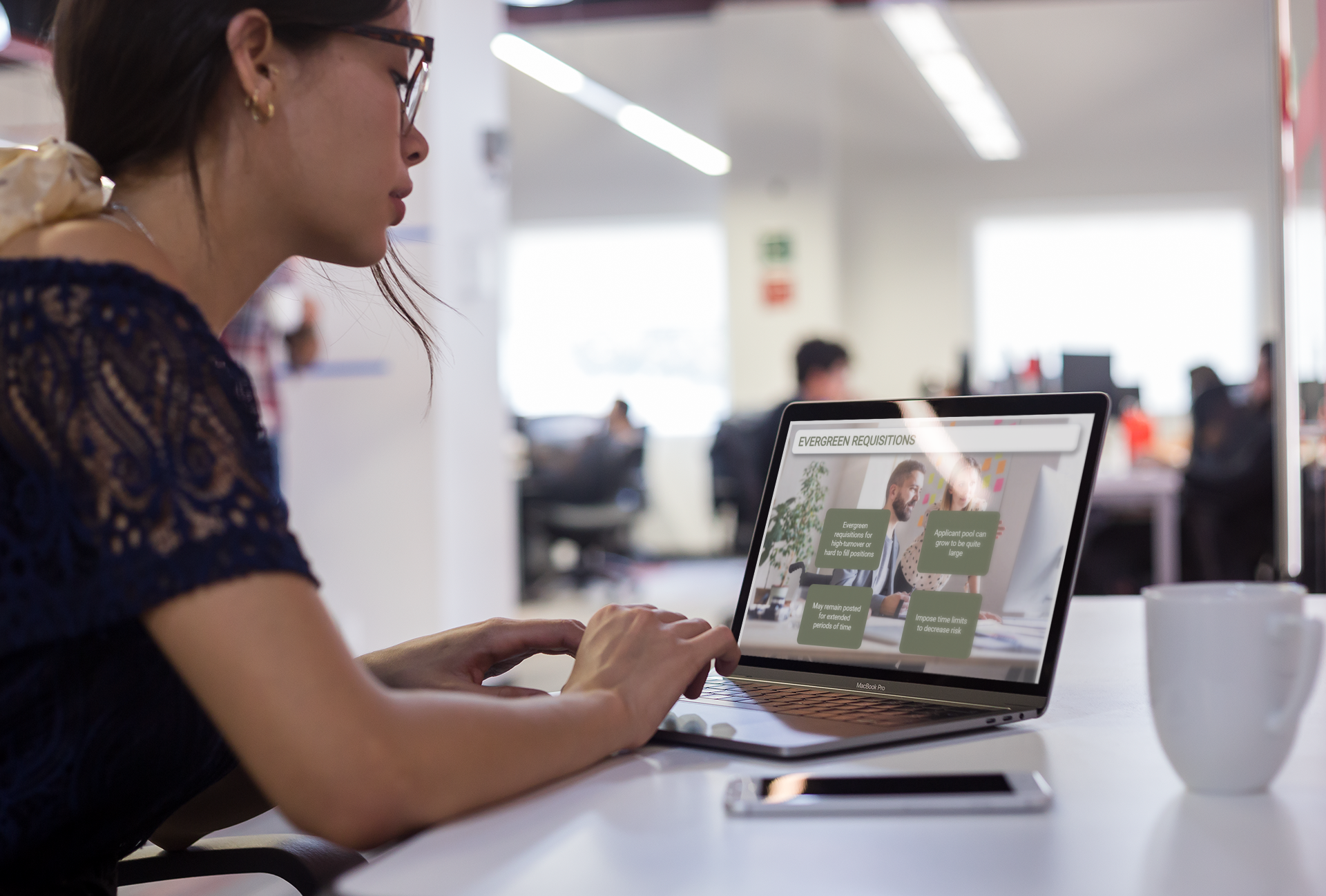 mockup-of-a-girl-working-on-her-macbook-at-a-modern-office-a21442 (2)
